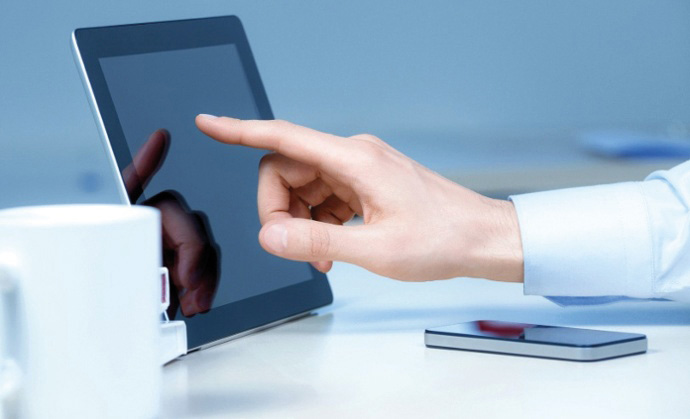 A hand touching a tablet