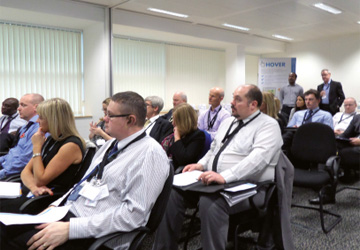an audience of business people watching a presentation