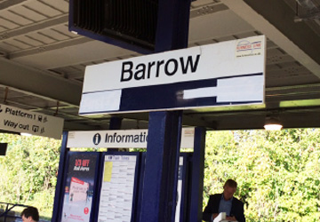 'Barrow' station sign with the information sign in the background